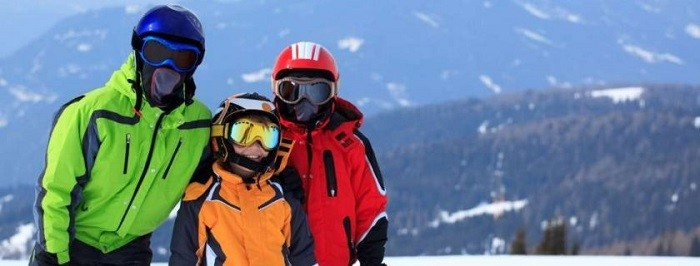 Family with ski goggles.