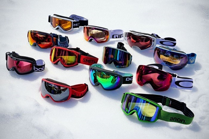 Many different ski goggles.